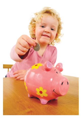 Girl placing money in a piggy bank